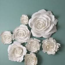 white paper flowers wall art