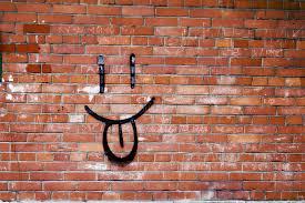 brick wall and smile graffiti smile