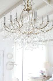 french cottage crystal chandelier in bedroom