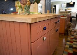Deep Sea Cameo And Custom Orange Kitchen Covered Bridge Cabinetry