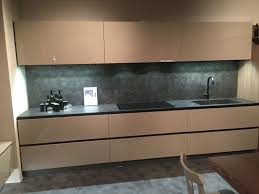 same material for backsplash and countertop with led under cabinet lighting