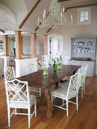 wood dining table white faux bamboo armchairs and white branch chandelier love the gray painted buffet hutch in this dining space