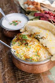 Authentic Chicken Biryani Served With Naan Bread Fragrant Pilau