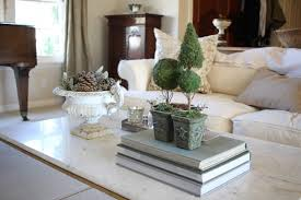 Your coffee table is the anchor of your living room, making a design statement and serving as a visual focal point. Styling A Coffee Table How To Blend Fall And Christmas