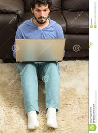 office shag. Download Young Man In Pajamas At Home Office. Sitting Shag Carpet Stock  Image - Office Shag 5