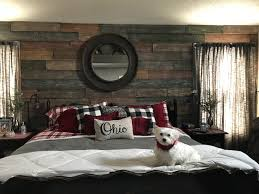 diy wood accent wall in a bedroom created with faux reclaimed panels