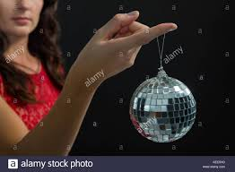 Mid section of woman holding mirror ball Stock Photo Royalty Free
