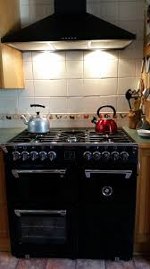 Black Belling Richmond 90cm Range Cooker and matching Canopy Rangehood  situated in an adorable country kitchen