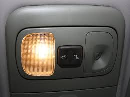this is located on the roof in the middle of the car typically this light turns on automatically