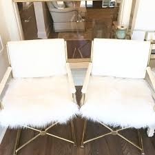 these newly refinished and reupholstered vintage brass and bamboo directors chairs in mongolian fur are fabooosh so cute at the ends of a breakfast table or