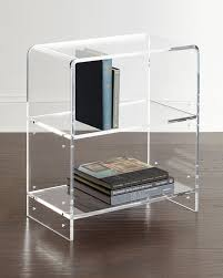Bookcase made of clear acrylic with waterfall curves. Two shelves; 11