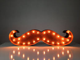 Vintage marquee lights... in the shape of a MOUSTACHE.