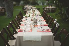 View in gallery Long party table with neon napkins