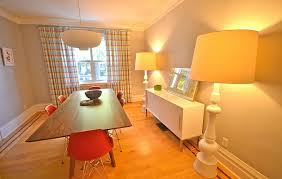 view in gallery eclectic and bright dining room with oversized floor lamps with yellow lampshades