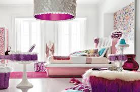 fancy teenage bedroom showed white theme and pink bed next to artistic blue table lamp on