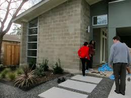Front of house style - concrete block, window, landscape lighting