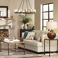 lighting for large rooms. A Large Chandelier Anchors Cozy Living Room With Rustic Touches. Lighting For Rooms N