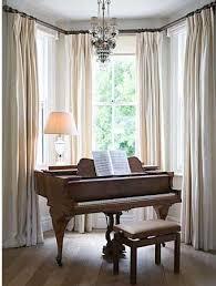 Baby Grand Piano in Bay Windows