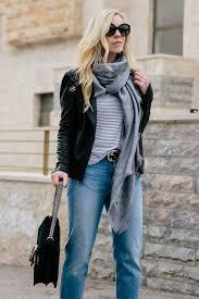 meagan brandon fashion blogger of meagan s moda wears black leather jacket with striped tee and gray louis vuitton monogram shine shawl scarf
