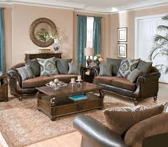 traditional brown living room in rich tones refined wood and blue dries to make the