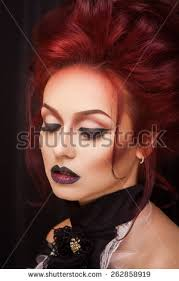y vire with gothic makeup and red hair close up portrait