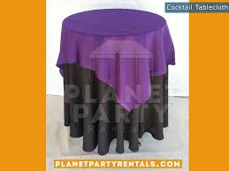 black tablecloth on cocktail table with purple overlay tablecloth linen als
