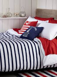 blue white red stripes anchor and boat on the pillow dreaming nautical dreams of blue ocean