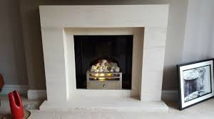 limestone and black granite fireplace surround