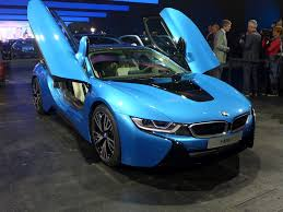 protonic blue bmw i8 luxury two seater car with open door wallpapers