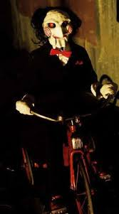 billy the puppet on a tricycle