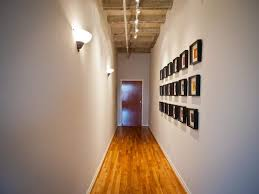hallway track lighting. Hallway Decorated With Framed Square Wall Decor And Illuminated Track Lighting Sconces : I