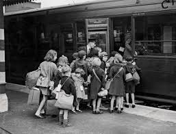 Photograph Children board a train to take them to the countryside  away from the
