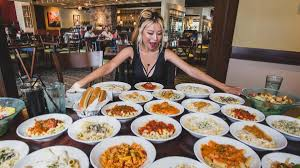 here s how olive garden s never ending pasta works guests with the pass get access to unlimited pasta soup or salad and breadsticks at any olive garden