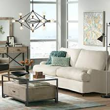 lighting a room. A Living Room With Retro Industrial Lighting And Wood Furniture Accents. A T