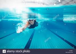 swimmer racing in pool stock image