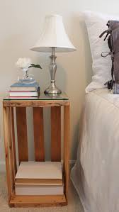 DIY - Fruit Crate turned Night Stand / Bedside Table the glass cut to fit  the top. Makes it looked finished!