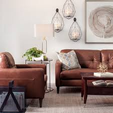 Rooms with white furniture Master Bedroom Living Room With Modern Brown Leather Furniture White Walls Gold Accents Schneidermans the Blog Schneidermans Furniture Decorating With Brown Leather Furniture tips For Lighter