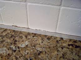 painting tile wallsolder and wisor Painting a Tile Backsplash and more easy kitchen