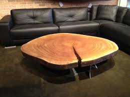 outstanding tree stump large coffee table with black faux leather sectional and brick wall exposed in retro classic interior ideas