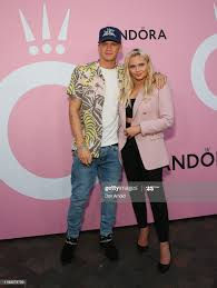 Cody Simpson and Alli Simpson attend ...