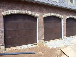 captivating faux wood garage door service installation duluth canton john paint cost update with stain overlay panel home depot lowe houston