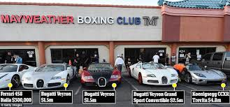 Bugatti veyron costă în jur de 1.400.000 de dolari. Floyd Mayweather Flashes His New Koenigsegg Three Bugattis And A Ferrari Worth A Combined 10 6m At His Gym In Las Vegas Daily Mail Online