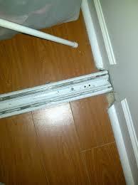 sliding closet door bottom track replacement