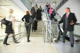 people on escalator. people on escalator and ladder e