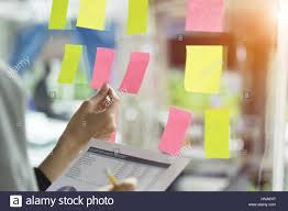 post business office. Business People Having A Meeting In Office, Post It Notes Glass Wall, Soft Focus Office I
