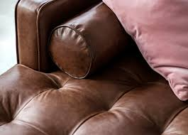 chocolate brown leather sectional sofa with pink velvet pillow