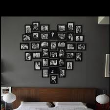 Going to try this when we decorate our bedroom! Looks brilliant, maybe not  the heart shape but the idea of photo wall above your bed.
