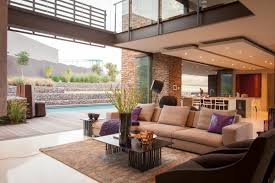 living space sofa rug coffee table terrace pool house in round rugs sofas luxurious johanne