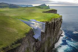 cliff hotel with breathtaking sea views built into cliff in iceland daily star