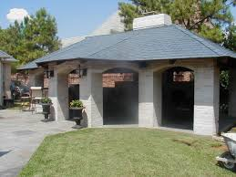 outdoor kitchen in pool cabana stone arches shingled roof